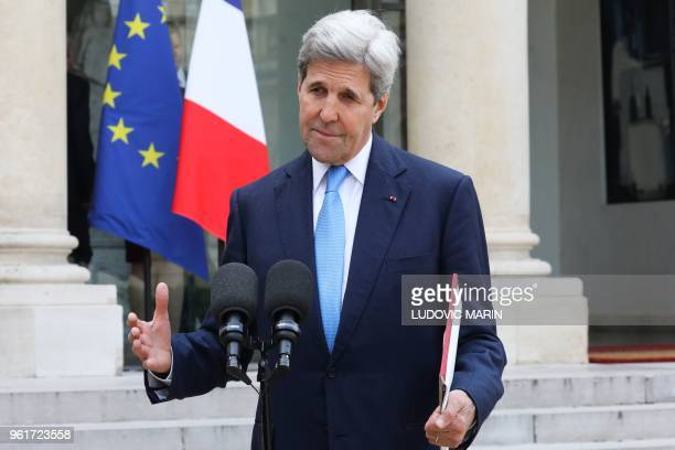 Former Secretary of State and member of the Carnegie foundation John Kerry gestures as speaks to the press while leaving the Elysee Palace in Paris,...