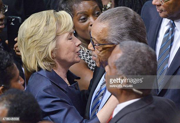 Former secretary of state and presidential hopeful Hillary Clinton hugs civil rights activist Al Sharpton during the funeral of Rev and South...