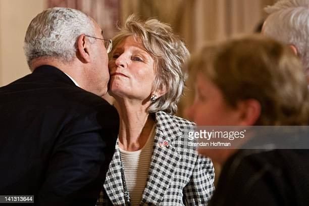 Former Secretary of State Colin Powell greets former Rep Jane Harman as he arrives for a lunch hosted in honor of Prime Minister David Cameron at the...