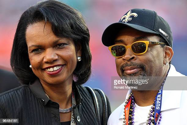 Former Secretary of State Condoleezza Rice and Director Spike Lee watch warmsups on the field prior to the start of Super Bowl XLIV between the...