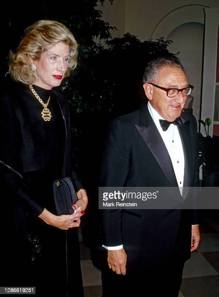 Former Secretary of State Henry Kissinger and his wife Nancy arrive at the White House to attend the State Dinner in honor of Prime Minister Margaret...