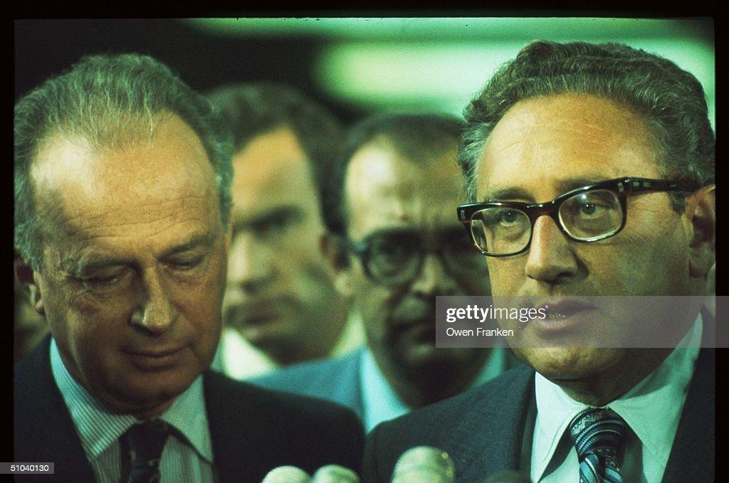 Former Secretary Of State Henry Kissinger Speaks While Standing Next To Israeli Leader Yi... : News Photo