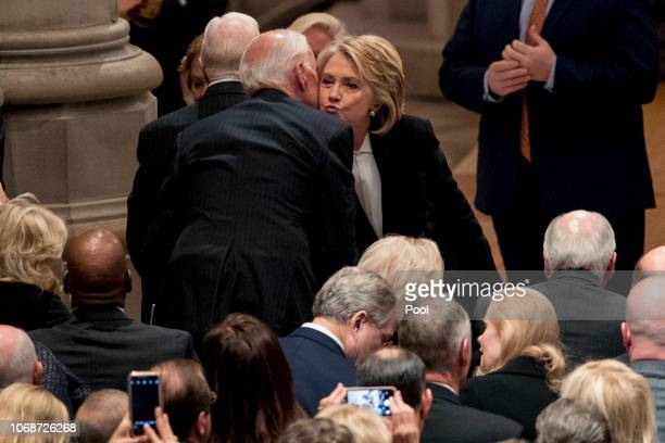 Former Secretary of State Hilary Clinton right greets former Vice President Joe Biden left before a State Funeral for former President George HW Bush...