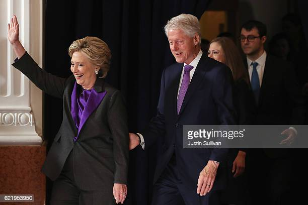 Former Secretary of State Hillary Clinton accompanied by her husband former President Bill Clinton takes the stage to concede the presidential...