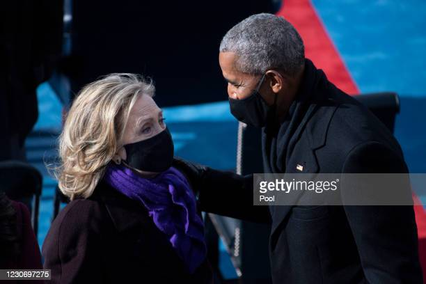 Former Secretary of State Hillary Clinton and former President Barack Obama talk at the end of the inauguration of U.S. President-elect Joe Biden on...
