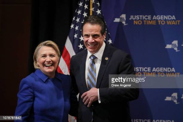 Former Secretary of State Hillary Clinton and New York Governor Andrew Cuomo smile at the end of an event to discuss reproductive rights at Barnard...