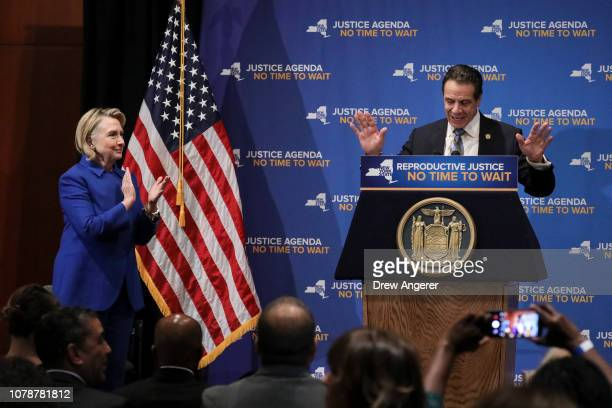 Former Secretary of State Hillary Clinton applauds as New York Governor Andrew Cuomo speaks about reproductive rights at Barnard College January 7...