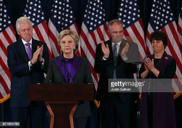 Former Secretary of State Hillary Clinton concedes the presidential election as former US President Bill Clinton Tim Kaine and Anne Holton listen at...