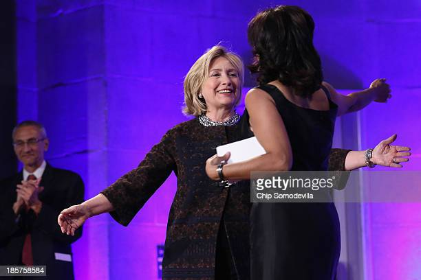 Former Secretary of State Hillary Clinton embraces Center for American Progress President Neera Tanden before adressing a gala celebrating the 10th...