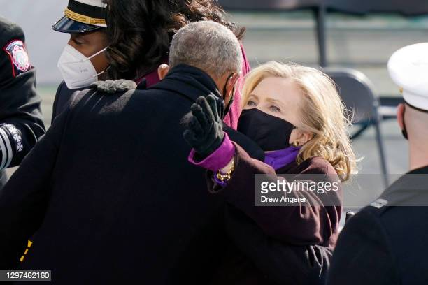 Former Secretary of State Hillary Clinton greets former U.S. President Barack Obama after the inauguration of U.S. President Joe Biden on the West...