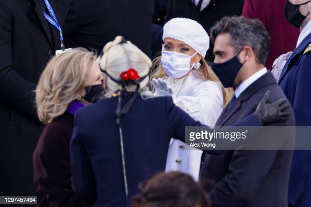 Former Secretary of State Hillary Clinton greets Lady Gaga and Jennifer Lopez during the inauguration of U.S. President Joe Biden on the West Front...