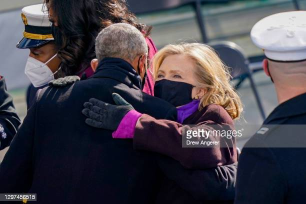 Former Secretary of State Hillary Clinton hugs former U.S. President Barack Obama after the inauguration of U.S. President Joe Biden on the West...