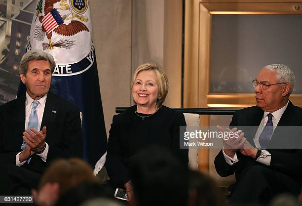 Former Secretary of State Hillary Clinton is applauded by Secretary of State John Kerry and former Secretary of State Colin Powell during a reception...