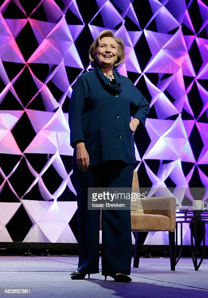 Former Secretary of State Hillary Clinton jokes after a woman threw an object toward her while she was delivering remarks at the Institute of Scrap...