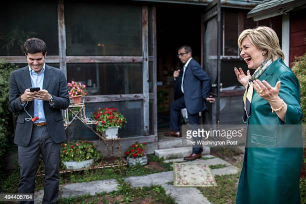 Former Secretary of State Hillary Clinton laughs at a supporter's joke as she leaves a farm in Muscatine, Iowa on Tuesday October 6, 2015.