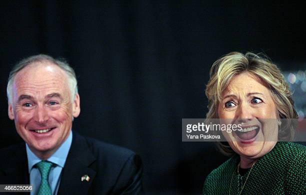 Former Secretary of State Hillary Clinton laughs during a ceremony to induct her into the Irish America Hall of Fame on March 16 2015 in New York...
