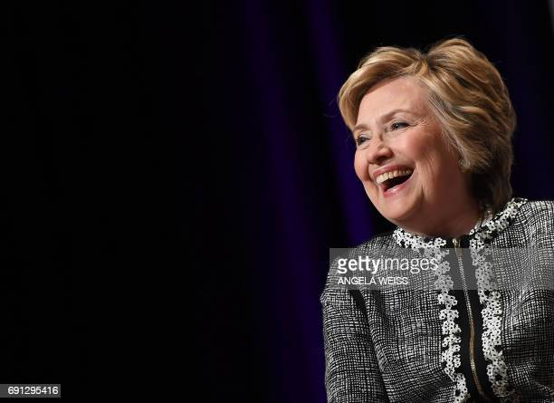 Former Secretary of State Hillary Clinton laughs onstage with novelist Cheryl Strayed at An Evening with Hillary Rodham Clinton during the BookExpo...