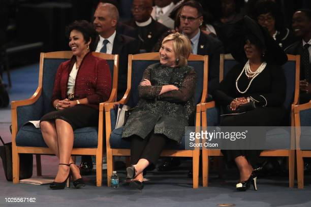 Former Secretary of State Hillary Clinton listens while her husband former President Bill Clinton speaks at the funeral for Aretha Franklin at the...
