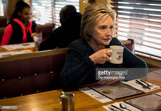 MANCHESTER NH Former Secretary of State Hillary Clinton meets and speaks to voters at a popular breakfast spot in Manchester New Hampshire on...