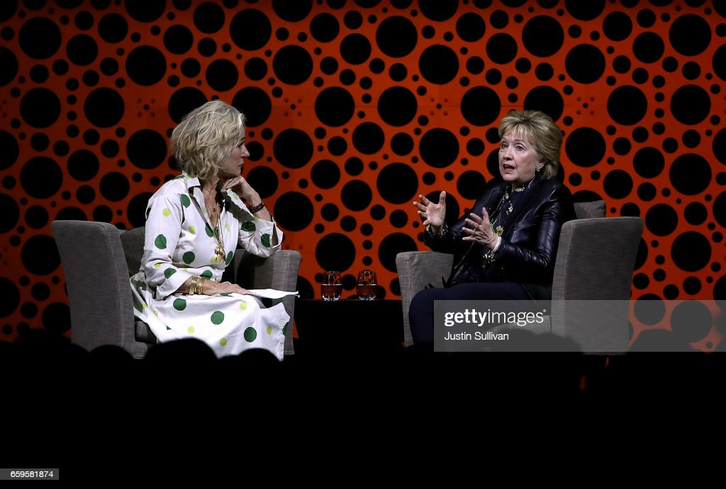 Former Secretary of State Hillary Clinton (R) speaks in conversation with Susie Tompkins Buell (L) during the 28th Annual Professional Business Women of California conference on March 28, 2017 in San Francisco, California. Hillary Clinton delivered the keynote address at the day-long conference featuring speakers, seminars and panel discussions with industry leaders.
