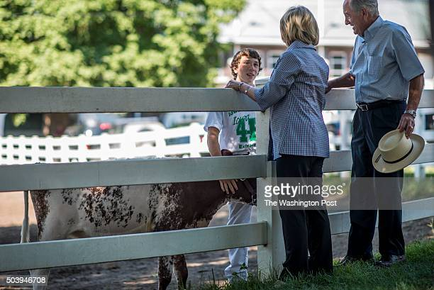 Former Secretary of State Hillary Clinton speaks to a 4H student along with former Iowa Senator Tom Harkin at the Iowa State Fair in Des Moines Iowa...