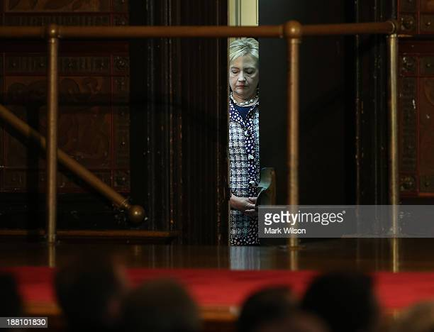 Former Secretary of State Hillary Clinton stands back stage as she listens to her introduction before speaking about the women of Afghanistan at...