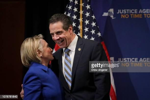 Former Secretary of State Hillary Clinton talks to New York Governor Andrew Cuomo at the end of an event to discuss reproductive rights at Barnard...