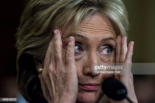 Former Secretary of State Hillary Clinton testifies and reacts to Chairman Trey Gowdy and Co Chairman Elijah Cummings arguing during the House Select...