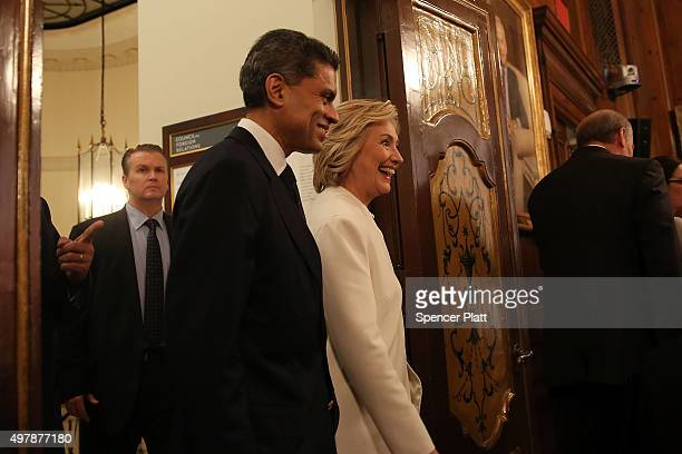 Former Secretary of State Hillary Clinton walks with Fareed Zakaria before a speech on her approach to defeating the Islamic State terrorist network...
