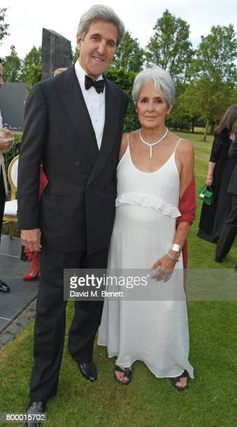 Former Secretary of State John Kerry and Joan Baez attend the Woodside Gallery Dinner in benefit of Elton John AIDS Foundation in partnership with...