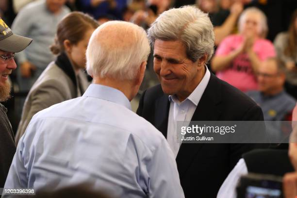 Former Secretary of State John Kerry greets Democratic presidential candidate former Vice President Joe Biden during a campaign event on February 01...