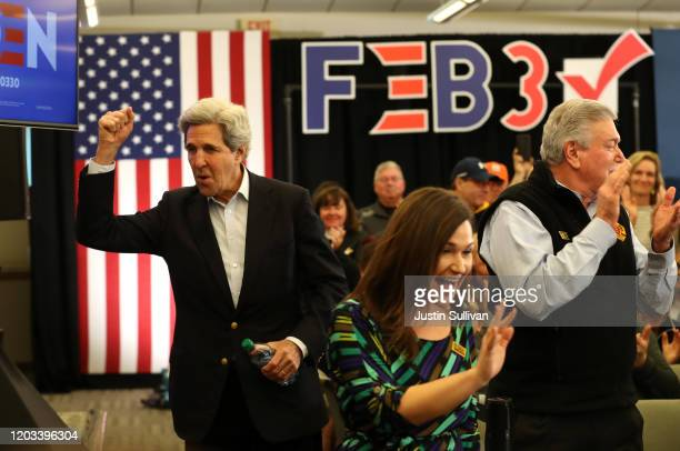 Former Secretary of State John Kerry greets voters during a campaign event for Democratic presidential candidate former Vice President Joe Biden on...