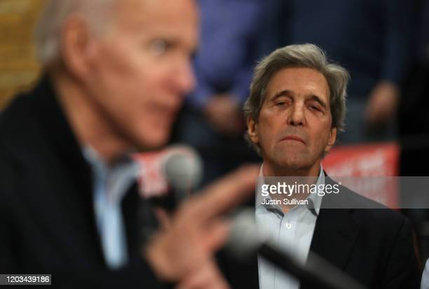 Former Secretary of State John Kerry looks on as Democratic presidential candidate former Vice President Joe Biden speaks during a campaign event on...