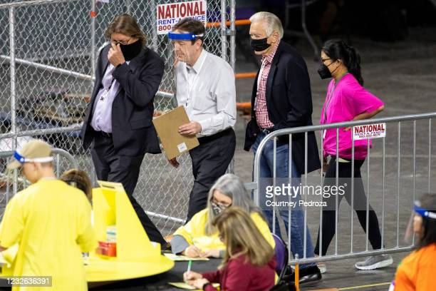 Former Secretary of State Ken Bennett works to move ballots from the 2020 general election at Veterans Memorial Coliseum on May 1, 2021 in Phoenix,...