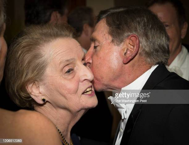 Former Secretary of State Madeleine Albright gets a peck on the cheek before the Gridiron Club Dinner at the Renaissance Hotel in Washington, D.C. On...