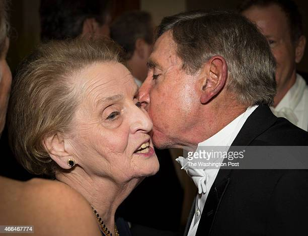Former Secretary of State Madeleine Albright gets a peck on the cheek before the Gridiron Club Dinner at the Renaissance Hotel in Washington DC on...