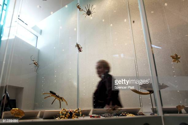 Former Secretary of State Madeleine Albright walks by her pin collection at the Museum of Arts and Design where it is currently on display on...