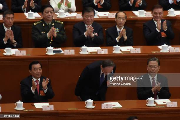 Former secretary of the Central Commission for Discipline Inspection Wang Qishan bows after hearing the results of his election as Chinese Vice...