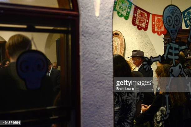 Former Secretary of the Interior Ken Salazar listens to Colorado Governor John Hickenlooper speak during organizing event October 26 2015 at Ken...