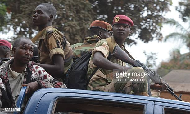 Former Seleka militants are escorted by Rwanda's MISCA peacekeepers out of Kasai military camp in Bangui on their way to another camp outside the...