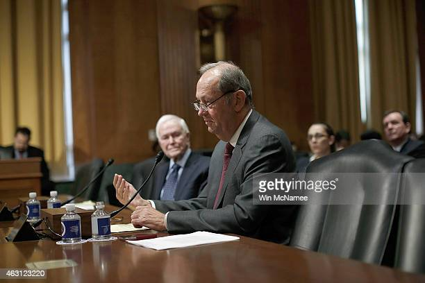 Former Sen Bill Bradley and Sen Bob Packwood testify before the Senate Finance Committee February 10 2015 in Washington DC The committee heard...