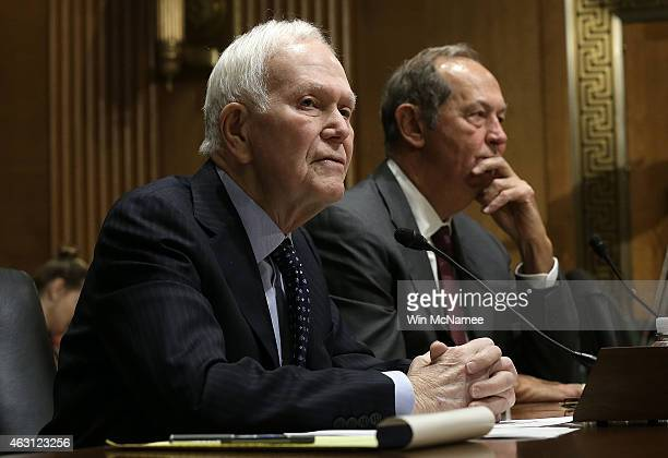 Former Sen Bob Packwood and former Sen Bill Bradley testify before the Senate Finance Committee February 10 2015 in Washington DC The committee heard...