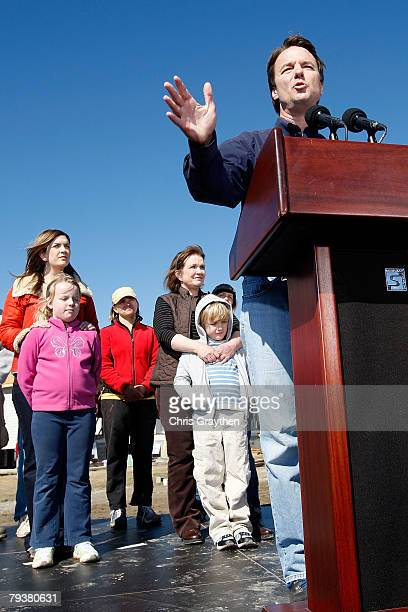 Former Sen John Edwards speaks to the media as his family daughters Cate and Emma Claire son Jack and wife Elizabeth look on January 30 2008 in New...