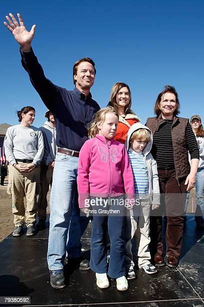 Former Sen John Edwards waves to the crowd with his family daughters Cate and Emma Claire son Jack and wife Elizabeth after announcing that is he...