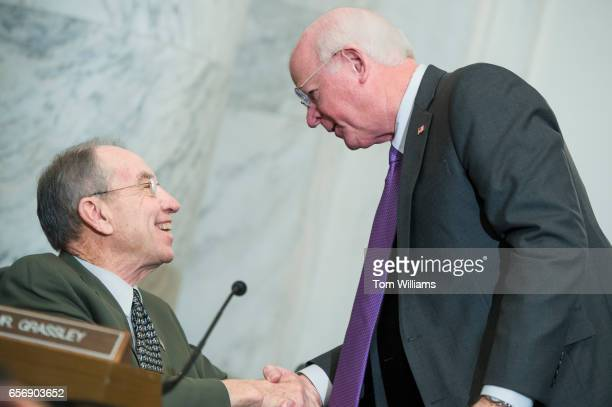 Former Sen Saxby Chambliss RGa right greets Sen Charles Grassley RIowa during the Senate Agriculture Committee confirmation hearing for Sonny Perdue...