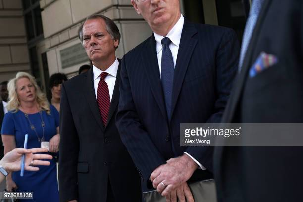 Former Senate Intelligence Committee Security Director James Wolfe listens as his attorney Benjamin Klubes makes a statement to members of the media...