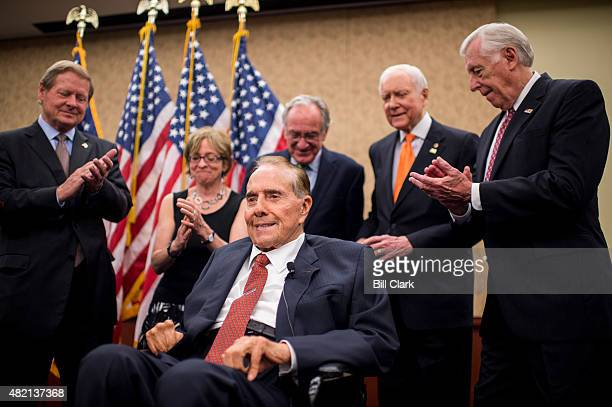 Former Senate Majority Leader Bob Dole RKan speaks during news conference in the Capitol Visitor Center marking the 25th anniversary of the Americans...