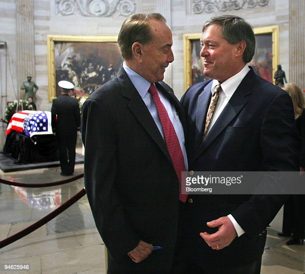 Former Senator Bob Dole left greets Jack Ford the son of former United States President Gerald R Ford near the casket of President Gerald R Ford as...