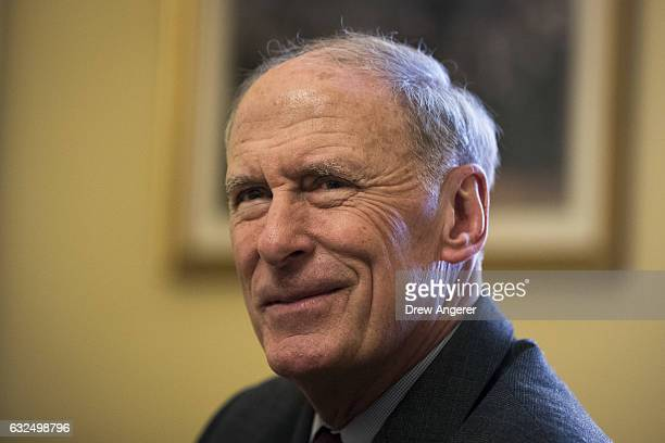 Former Senator Dan Coats Presidentelect Donald Trump's nominee for Director of National Intelligence looks on during a photo opportunity in the...