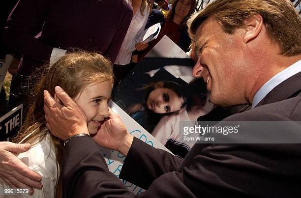 Former Senator John Edwards greets Jordan Segal of Greensboro NC after a news conference with Sen Ted Kennedy DMass to promote a fair minimum wage...